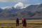 Nomadic Tibetan women walking in front of Mt. Kailas, the sacred source of four major Himalayan rivers. Ngari, Tibet Autonomous Region, China.